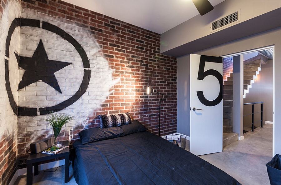 Industrial-style-bedroom-with-brick-wall-and-trendy-graffiti-art