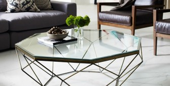 1490594392_A-geometric-glass-coffee-table-adds-dynamic-and-transparency-to-the-room-