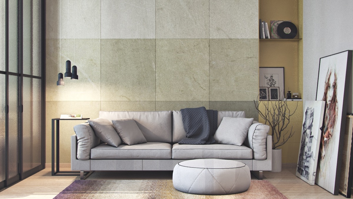 Beige-tiled-wall-grey-couch-white-ottoman-living-room