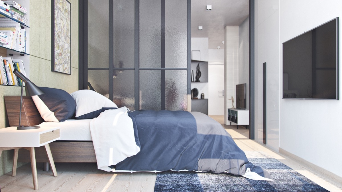 Frosted-glass-partition-wall-charcoal-and-white-bedding-bedroom